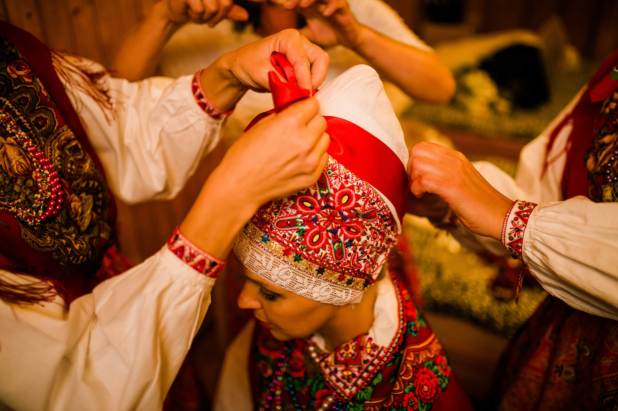 Traditional Kihnu bride is getting ready before her wedding day in Estonia