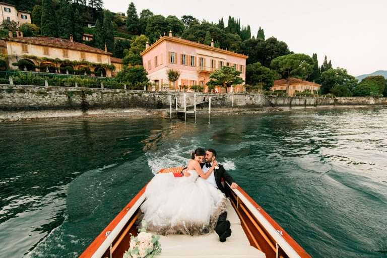 Bride and groom having a boat ride on Lake Como in Italy